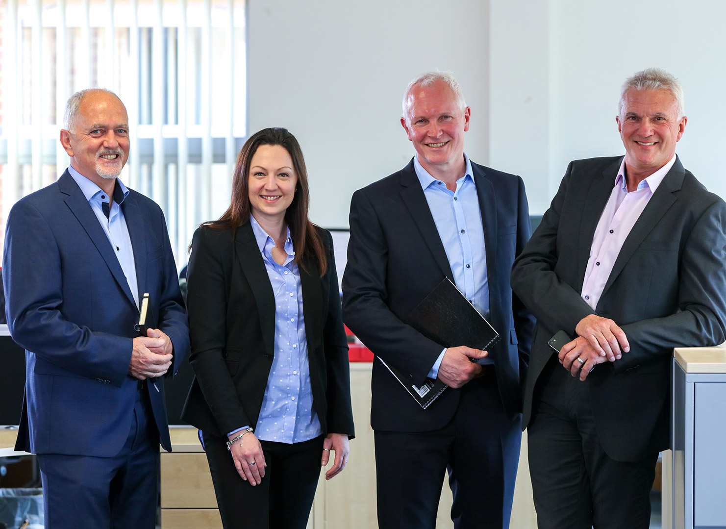 Partial management buyout led by directors Stephanie Barnett-Dean and Mark MacDonald (centre) Martyn Cashmore (far left) and Ken Amott (far right).